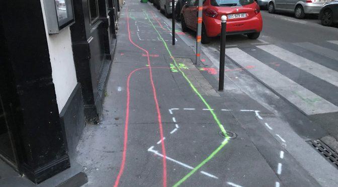 With chalk on asphalt